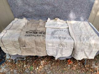 five old seed or flower bags