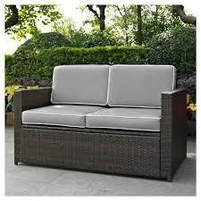 Palm Harbor Outdoor Wicker loveseat In Brown with Grey Cushions  Retail 347 99