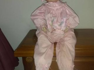 Doll With Ceramic Face And Hands Dressed In Night Clothes