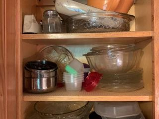 Contents of Cabinet in Kitchen Including Pottery Bowl Casserole Dishes Batter Bowl Mixing Bowls Cheese Shakers