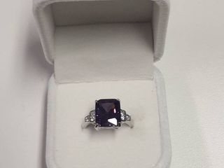 Ring with Purple Stone in Box