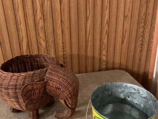 A wicker elephant and a John Deere bucket
