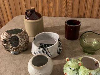 Assorted flowerpots and jug