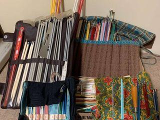 large assortment of knitting needles