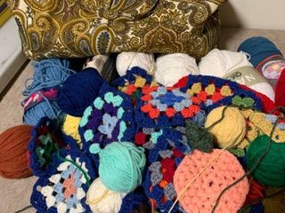 Assorted yarn with granny squares and carrying case