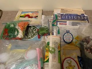 Assortment of needlepoint With knitting box