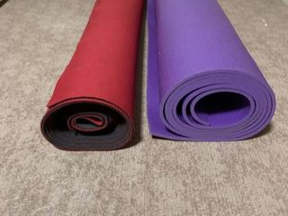 roll of Neoprene floor protector and roll of yoga mat material