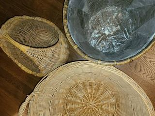 3 Round Wicker Baskets  The middle one is lined in plastic