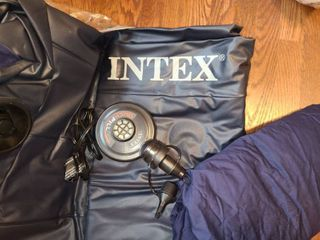 Full Sized INTEX AIR MATTRESS with INTEX AIR PUMP  also comes with a full size fitted sheet