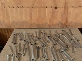 Assorted wrenches with organizer board