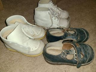 BABY SHOES The larger of the walking shoe a k a  WINNIE THE POOH SHIES are a size 4