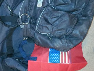 luggage  EDDIE BAUER Duffle Bag with wheels  WENDY BEllISSIMO Supply Satchel  and a bag with the flag