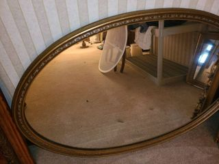 1 large Oval Shaped Mirror