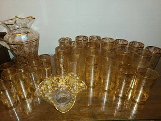 38 pcs  Iced Tea Set  Had Gold design all around  36 glasses  3 different sizes with Candy Dish and Pitcher