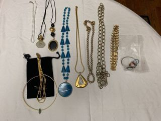 ladies jewelry  10 necklaces  one watch and matching earrings