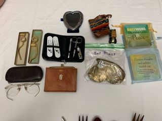 Manicure set  billfold  affirmation cards  picture frame  two eyeglasses  belt buckle  small bag  two tiny pipes and a toy car