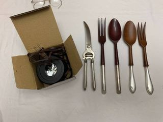 two sets of salad forks  a scissors and a light base