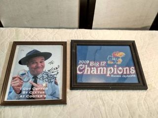 2 pictures one is 2009 big 12 championship Kansas jayhawks the other is a signed picture by Cletus that says I got cuffed by Cletus at cooter s