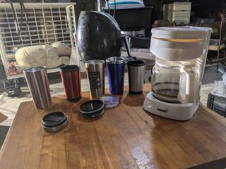 Coffee Pot And Assorted Mugs