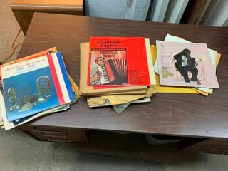 Variety of vinyl records and sheet music