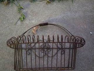 wrought iron planter with water can