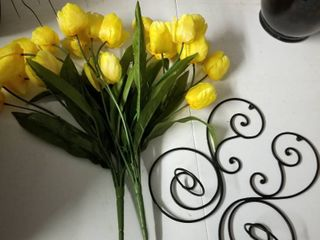 metal sconces with yellow tulip stems