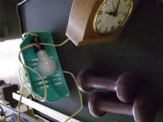 clock   dumbbells   headboard light