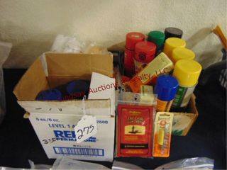 lot of cleaning supplies  oils  cloths  patches