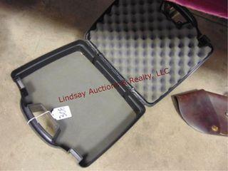 Small black plastic hard hand gun case
