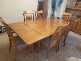 Oak Bassett Dining Table with 6 Chairs  Excellent Condition   Seats 12 with leaf