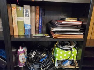 lot of leather Binders  Bible Sleeves  and Various Versions of The Bible   lot also includes Various Computer Cords