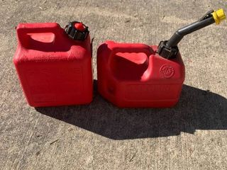 Two 1 Gallon Gas Cans location Shed
