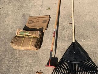 Garden Hoe Rake and Bundle of lawn and leaf Bags location Shed