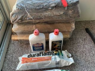 Two Duraflame logs and Two Bundles of Fire Wood location Patio