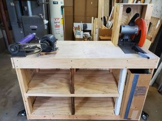 Makita Portable Cut off Metal Cutting Saw  and Craftsman Rotating Sander  Includes Wooden Workbench with Wheels and Cubbies also a Make Shift Trashcan  Also has Power Strip and Switch for Power