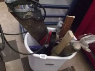 bucket of tools   saw   caulking gun   bat   range cord