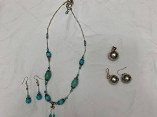 ladies jewelry  one turquoise necklace with earrings and one pendant with earrings