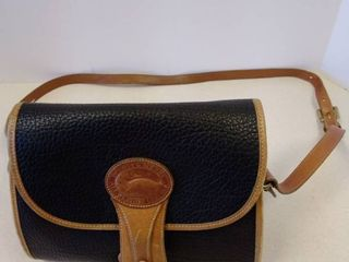 Dooney   Bourke black and brown all weather leather crossbody purse