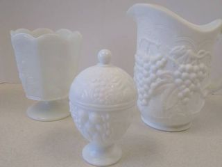 Milk glass pitcher  vase  and trinket holder
