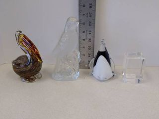 lot of glass statues and paper weight