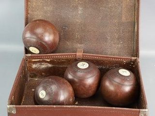 lawnbowling balls in suitcase