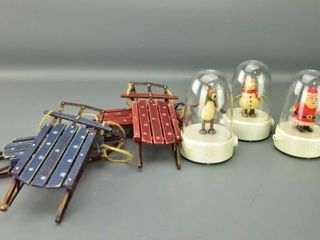 snow globe music boxes and sleigh ornaments