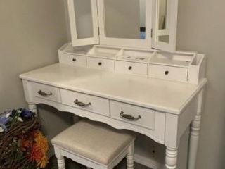White vanity with bench