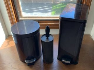 Assorted trash cans and bathroom supplies