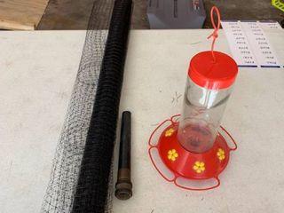Chicken fencing  hose extension and birdfeeder