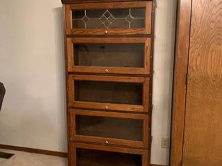 lawyers cabinet with one piece of missing glass