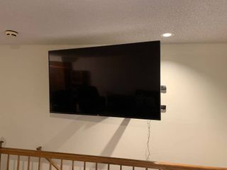Vizio 70 inch Internet capable television set wall mounted