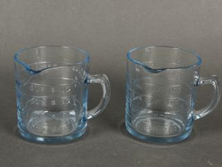 lOT OF 2 BlUE PATTERN GlASS MEASURING CUPS