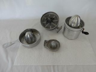 GROUPING OF 4 HOME SERVICE TIN JUICE REAMERS
