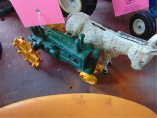 Cast iron donkey bank   JD tractor